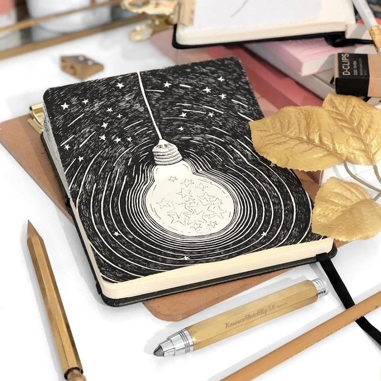 Художница заполняет свои альбомы рисунками с фантастическими мирами, в которых вы захотите жить